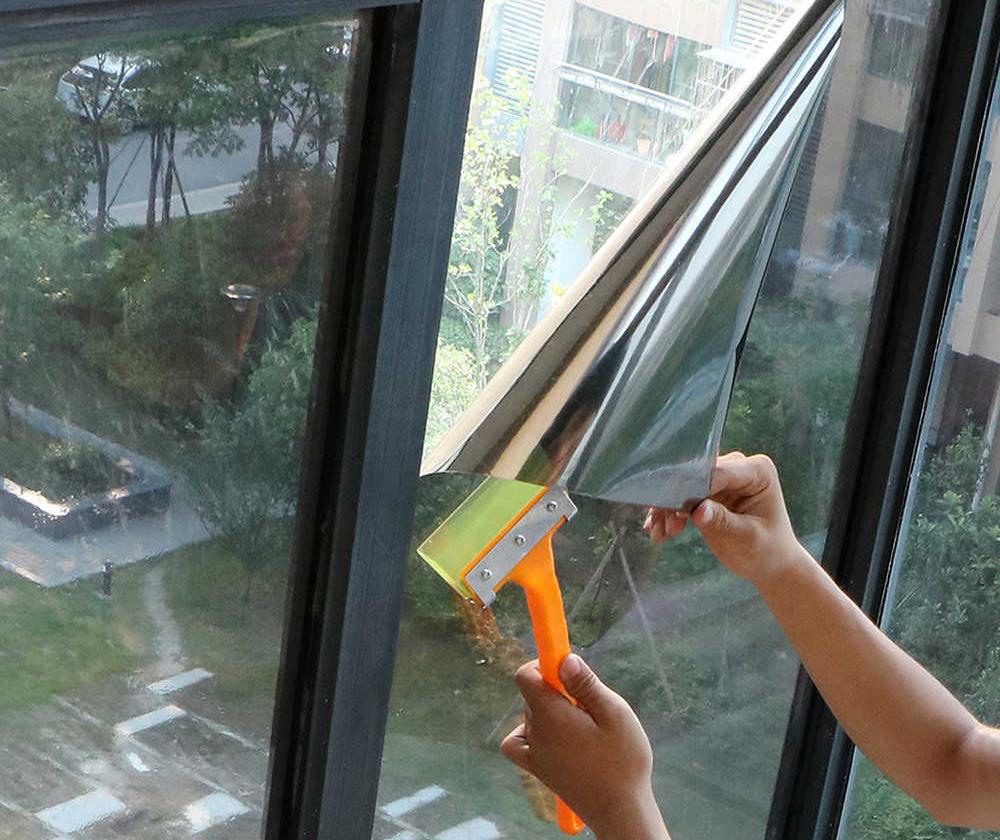 Поклейка пленки на окна